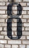 Number eight on brick wall. Royalty Free Stock Image