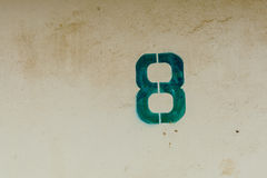 Number eight with grunge wall Royalty Free Stock Photography