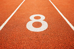 Number eight on running track Stock Photo
