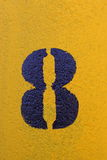 Number eight stenciled in black on yellow surface Royalty Free Stock Photography