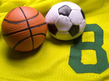 Number eight uniform and balls. Soccer and basketball balls on the uniform Royalty Free Stock Photo