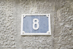 Number eight on the wall of a house Stock Images