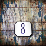 Number eight on wooden background Royalty Free Stock Photography