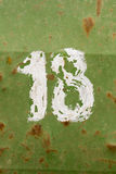 Number eighteen painted on a old green metal barrel Royalty Free Stock Images