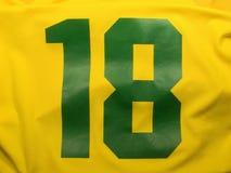 Number eighteen uniform. Yellow and green number eighteen uniform Royalty Free Stock Image
