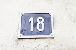 Number eighteen in a wall Royalty Free Stock Photo