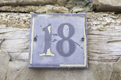 Number eighteen in a wall of a house Royalty Free Stock Images