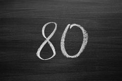 Number eighty enumeration written with a chalk on the blackboard Stock Images
