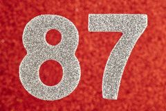 Number eighty-seven silver color over a red background. Annivers. Ary. Horizontal Stock Illustration