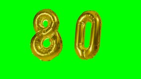 Number 80 eighty years birthday anniversary golden balloon floating on green screen -. Number 80 eighty years birthday anniversary golden balloon floating on stock video