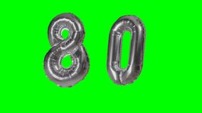 Number 80 eighty years birthday anniversary silver balloon floating on green screen -. Number 80 eighty years birthday anniversary silver balloon floating on stock video
