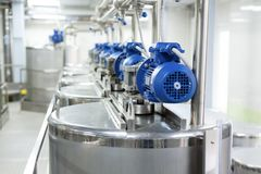 A number of electric motors with reducers. Tanks for mixing liquids. stock photos