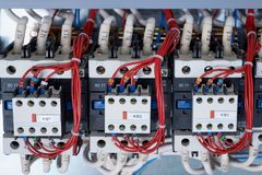 A number of electrical contactors with additional contacts installed on them. A number of electrical contactors with additional contacts installed in the stock images