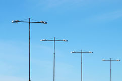 A number of electrical poles. Stock Photography