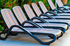 Number of empty sunbeds around the pool at the hotel Royalty Free Stock Image