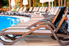 Number of empty sunbeds around the pool in the morning Stock Photo
