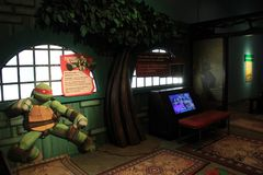 Number of exhibits under soft lighting, this one of Ninja Turtles, Strong Museum, Rochester NY, 2017. Number of fun and interesting exhibits, this one covering Stock Photos