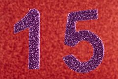 Number fifteen purple color over a red background. Anniversary. Horizontal Royalty Free Stock Photo