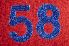 Number fifty-eight blue color over a red background. Anniversary Stock Images