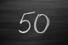 Number fifty enumeration written with a chalk on the blackboard Royalty Free Stock Photo