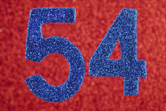 Number fifty-four blue over a red background. Anniversary. Stock Photo