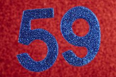 Number fifty-nine blue color over a red background. Anniversary stock photography