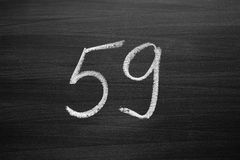 Number fifty nine enumeration written with a chalk on the blackboard Stock Image