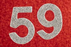 Number fifty-nine silver color over a red background. Anniversar. Y. Horizontal Stock Image