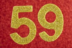 Number fifty-nine yellow color over a red background. Anniversary stock images