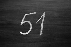 Number fifty one enumeration written with a chalk on the blackboard. Closeup view Stock Photo
