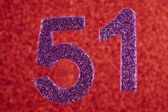 Number fifty-one purple over a red background. Anniversary. stock photography