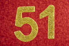Number fifty-one yellow over a red background. Anniversary. Stock Photo