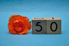 Number fifty with an orange rose stock image
