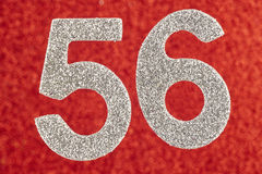 Number fifty-six silver color over a red background. Anniversary Stock Photos