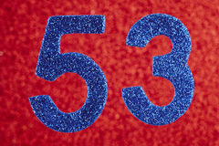 Number fifty-three blue color over a red background. Anniversary royalty free stock photo