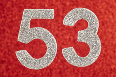 Number fifty-three silver color over a red background. Anniversa Stock Images