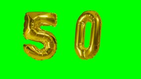Number 50 fifty years birthday anniversary golden balloon floating on green screen -. Number 50 fifty years birthday anniversary golden balloon floating on green stock video
