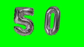 Number 50 fifty years birthday anniversary silver balloon floating on green screen - stock video footage