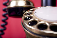 Number Five. 1910-1920 Candlestick telephone, in a home, with Number five highlighted on the dial Royalty Free Stock Images