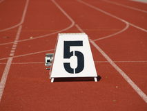 Number Five. Start block 100 meter dash in Field and Track Royalty Free Stock Photography