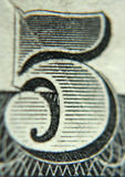 Number Five. A close shot of the number five on an American five dollar bill Stock Photos