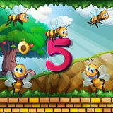 Number five with 5 bees flying in garden Royalty Free Stock Image