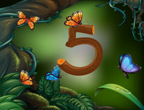 Number five with 5 butterflies in the garden Stock Photo