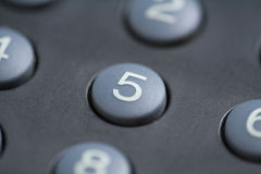 Number five button. A close up of a number five button on a remote control stock photography