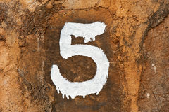 Number five on dirty wall Stock Image