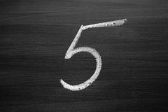 Number five enumeration written with a chalk Stock Image