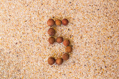 The number five 5 made out of fruit lichee Royalty Free Stock Photos