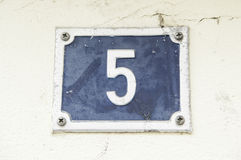 Number Five On The Wall Of A House Stock Photos