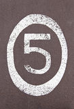 Number five painted on the ground Royalty Free Stock Photography