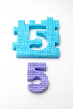 Number five puzzle mats. Focus on the front (small DOF) Royalty Free Stock Photos